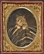 Cat posed with Mexican serape, ca. 1866-1868