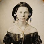 [Portrait of a woman with elaborate cameo jewelry and off the shoulder dress], ca. 1857, ambrotype